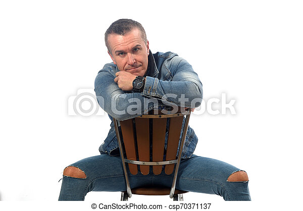 man sitting on a chair with white background - csp70371137