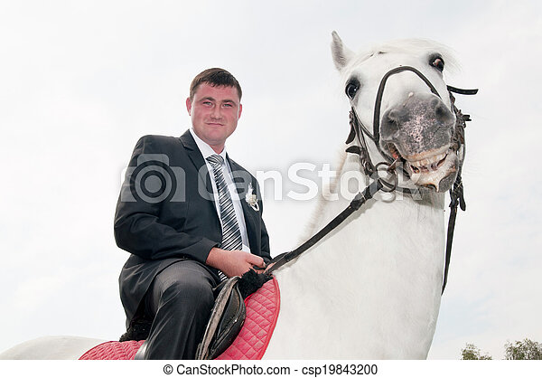 man sitting on a horse - csp19843200
