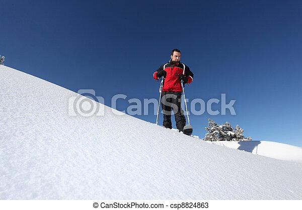 Man skiing alone - csp8824863