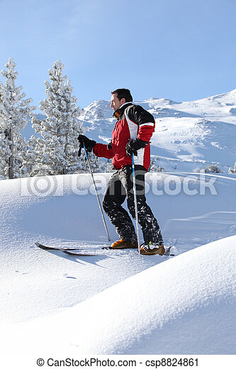 Man skiing on a sunny day - csp8824861