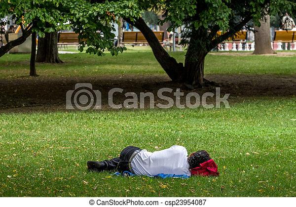 man sleeping in the park - csp23954087
