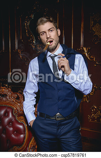 man smoking a cigar - csp57819761