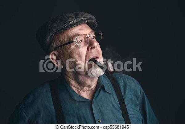 man smoking a pipe - csp53681945