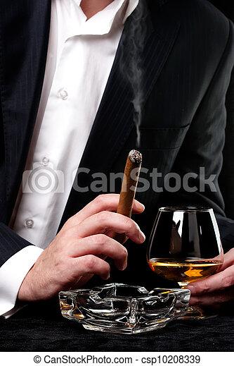 Man smoking cigar and drink cognac - csp10208339
