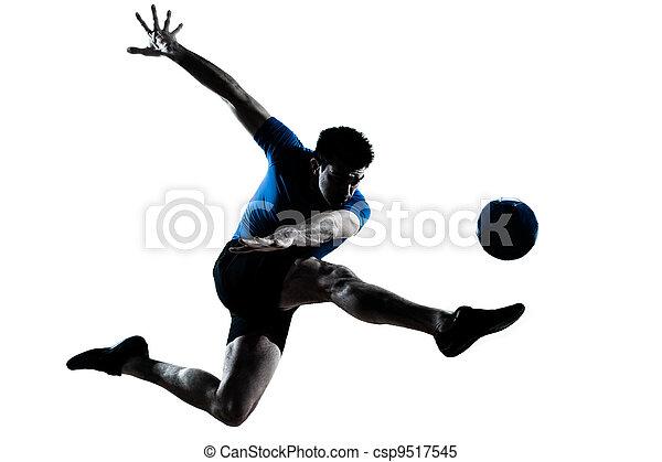 man soccer football player flying kicking - csp9517545