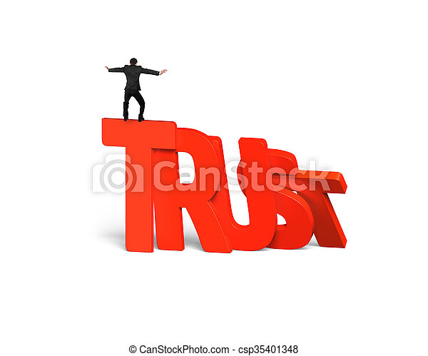 Man standing balancing on trust word dominoes falling - csp35401348