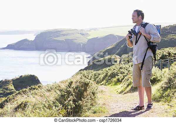 Man standing on cliffside path - csp1726034