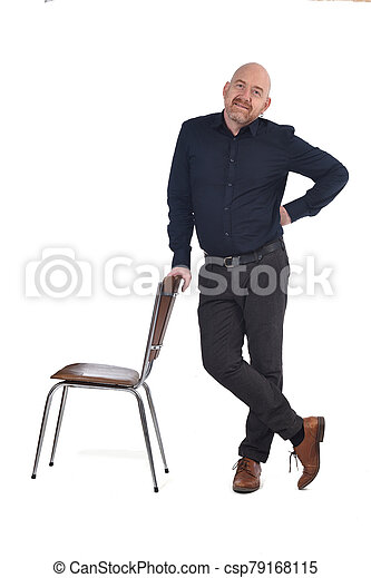 man standing with a chair in white background - csp79168115