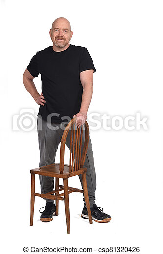 man standing with a chair in white background - csp81320426