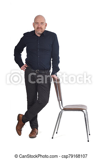 man standing with a chair in white background - csp79168107