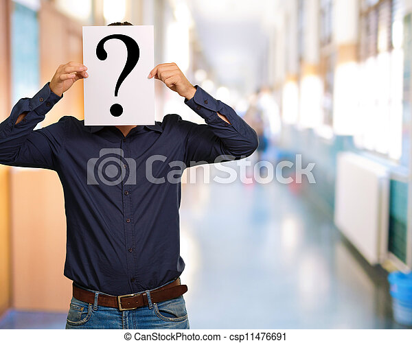 Man standing with a question mark board - csp11476691