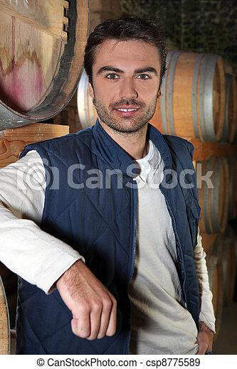 Man stood in wine cellar - csp8775589