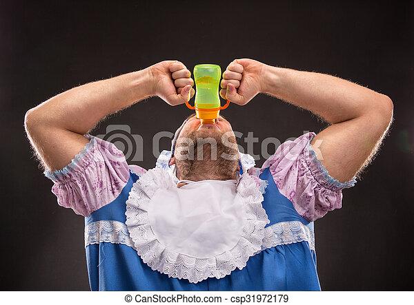 Man sucking a baby bottle - csp31972179