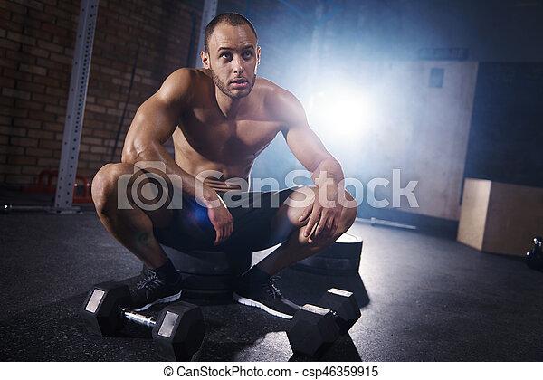 Man taking break from crossfit training - csp46359915