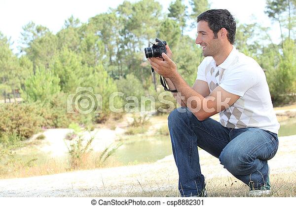 Man taking photo - csp8882301