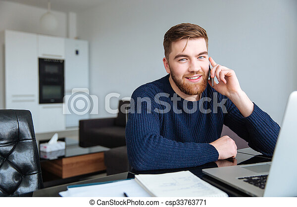 Man talking on the phone at home - csp33763771