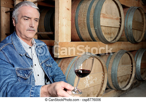 Man tasting wine in cellar - csp8776006
