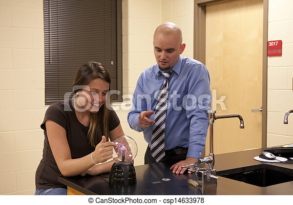 Man teaching science to a female student. - csp14633978