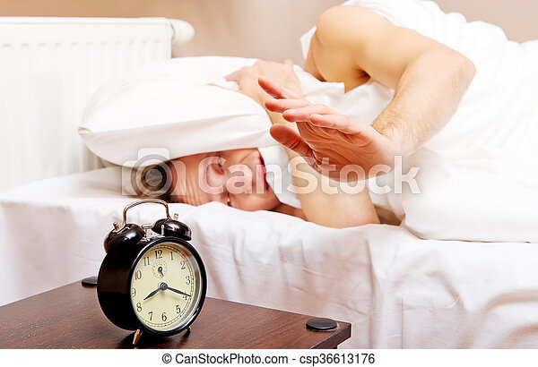 Man trying to sleep, when alarm clock ringing - csp36613176