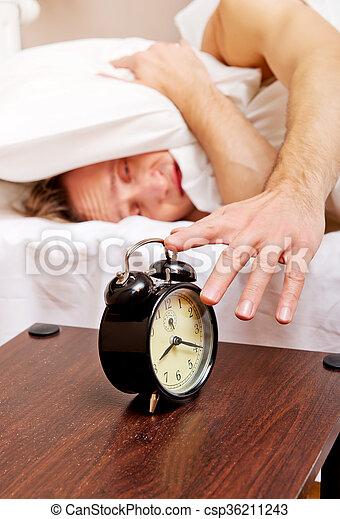 Man trying to sleep, when alarm clock ringing - csp36211243