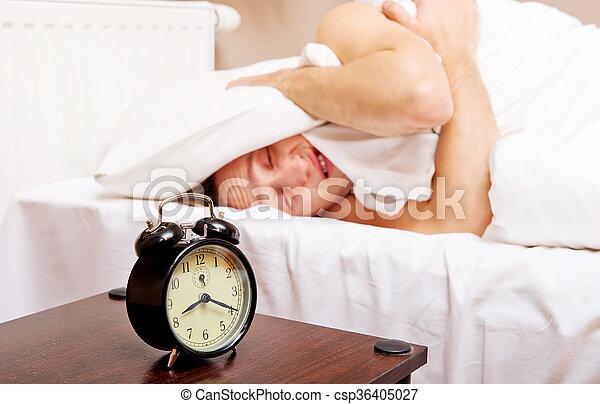 Man trying to sleep, when alarm clock ringing - csp36405027