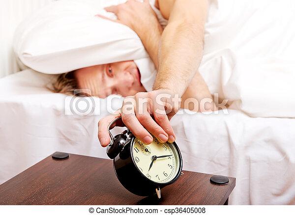 Man trying to sleep, when alarm clock ringing - csp36405008