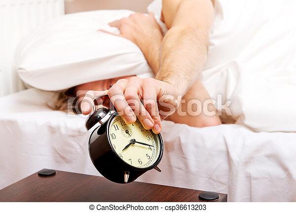 Man trying to sleep, when alarm clock ringing - csp36613203