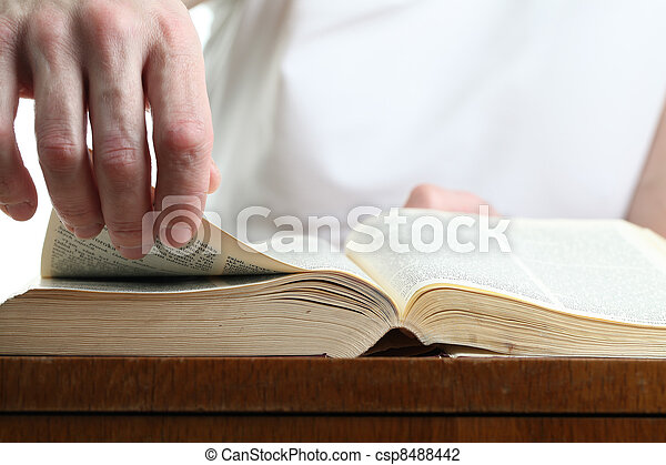 Man turning the page of the Bible - csp8488442