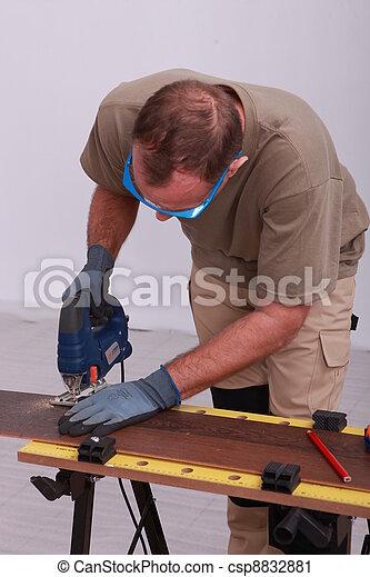 Man using a jigsaw - csp8832881