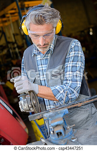 Man using angle grinder - csp43447251