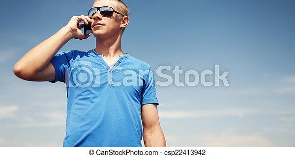 Man using mobile smart phone outdoor - csp22413942