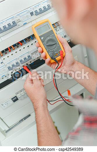 Man using multi meter - csp42549389