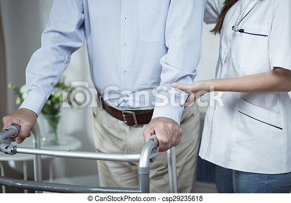 Man using walking frame - csp29235618