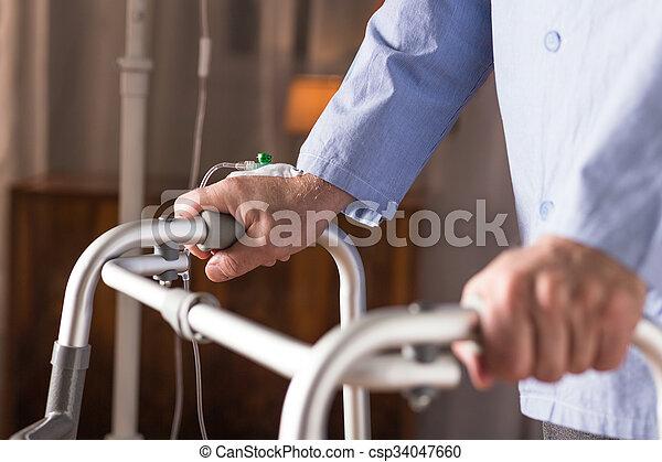 Man using walking frame - csp34047660