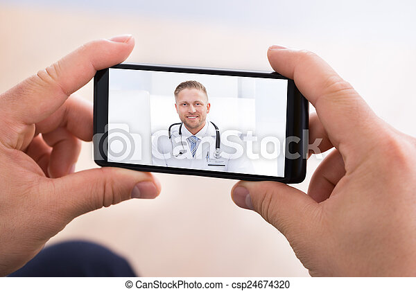 Man Video Chatting With Doctor - csp24674320