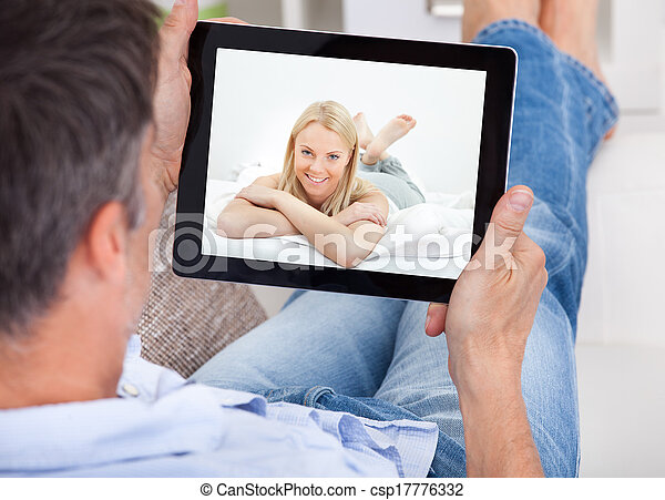 Man Video Chatting With Woman - csp17776332
