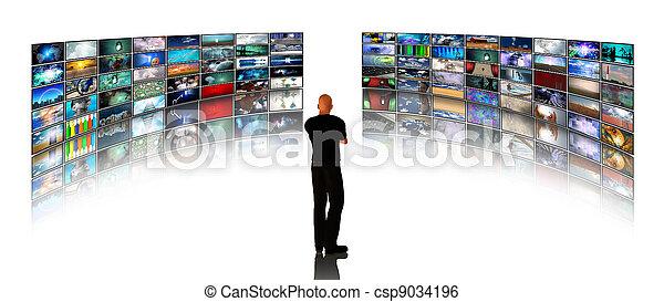Man viewing video displays - csp9034196