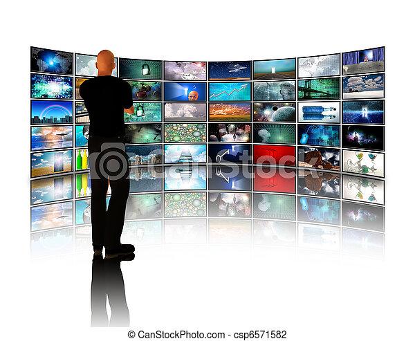 Man viewing video displays - csp6571582