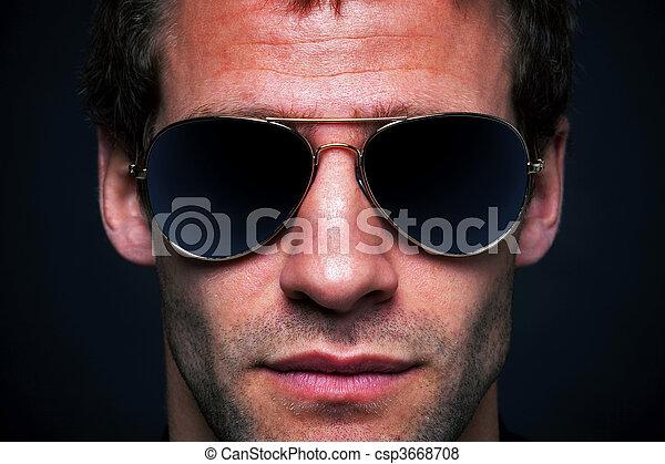 Man wearing aviator sunglasses - csp3668708