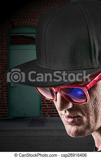 Man wearing baseball cap and sunglasses. Handsome man wearing a ... 7a804096fc63