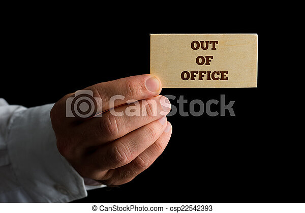 Man with a business card reading out of office man holding a man with a business card reading out of office csp22542393 reheart Gallery