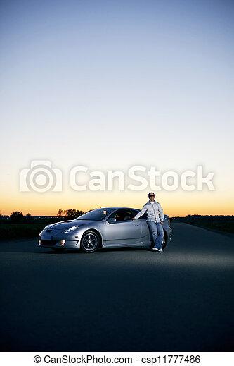 Man with a car at sunset - csp11777486