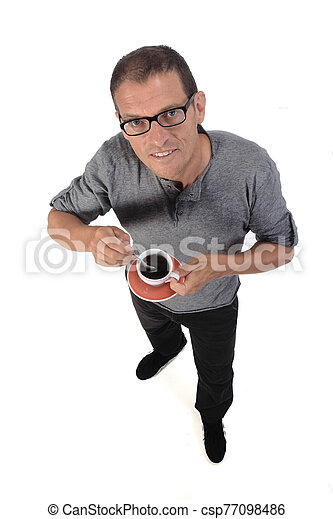 man with a cup of coffee on white background - csp77098486