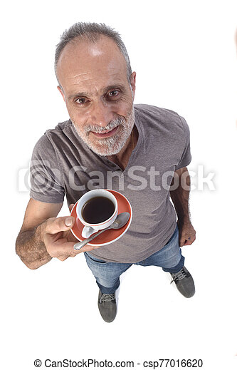 man with a cup of coffee on white background - csp77016620
