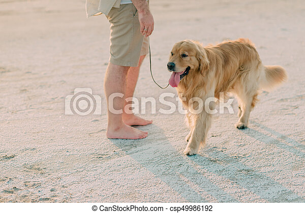 Man with a dog on the seashore - csp49986192