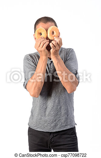 man with a donut on white background - csp77098722