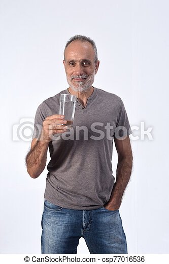 man with a glass water on white background - csp77016536