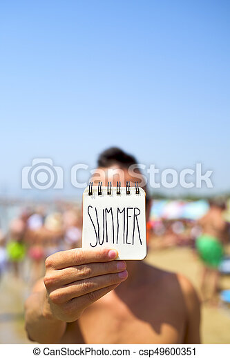 man with a note with the word summer - csp49600351