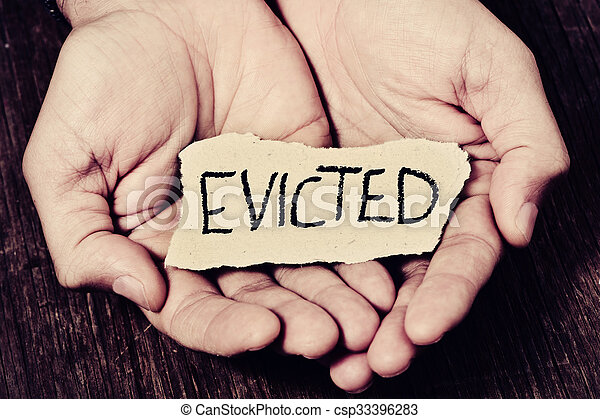 man with a piece of paper with the word evicted - csp33396283