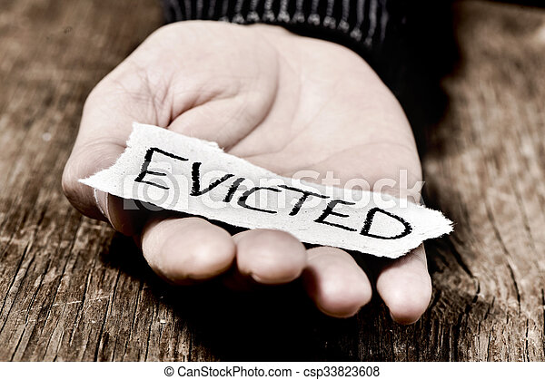 man with a piece of paper with the word evicted - csp33823608
